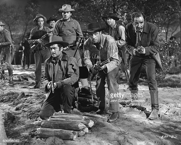 Frank Lovejoy as Sergeant Charlie Baker Neville Brand as Private Morgan and Guy Madison as Miles Archer in the 1953 western The Charge at Feather...