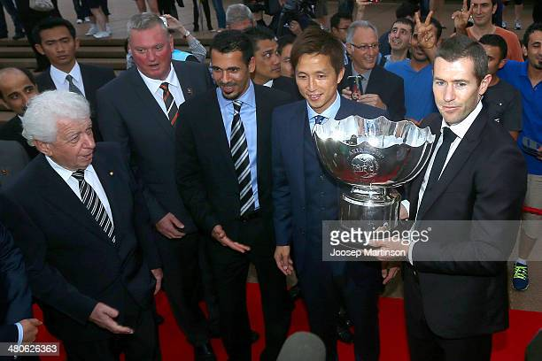 Frank Lowy Michael Brown Younis Mahmoud Takashi Fukunishi and Brett Emerton pose with the AFC Asian Cup trophy ahead of the the 2015 AFC Asian Cup...