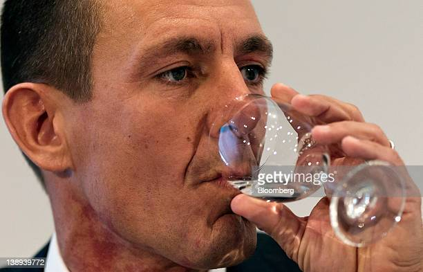 Frank Lutz chief financial officer of MAN SE drinks water from a glass during a news conference in Munich Germany on Tuesday Feb 14 2012 MAN SE the...