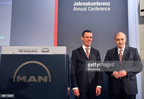 Frank Lutz chief financial officer of MAN SE left and Georg Pachta Reyhofen chief executive officer of MAN SE pose prior to the company's news...