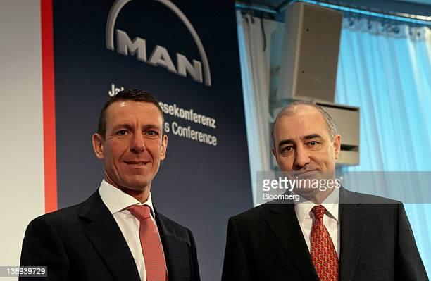 Frank Lutz chief financial officer of MAN SE left poses for a photograph with Georg PachtaReyhofen chief executive officer of MAN SE during a news...