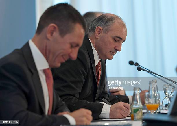 Frank Lutz chief financial officer of MAN SE left sits alongside Georg PachtaReyhofen chief executive officer of MAN SE during a news conference in...