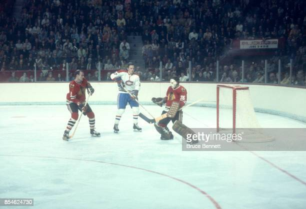 Frank Mahovlich of the Montreal Canadiens looks for the rebound as goalie Tony Esposito and Bill White of the Chicago Blackhawks defend the net...