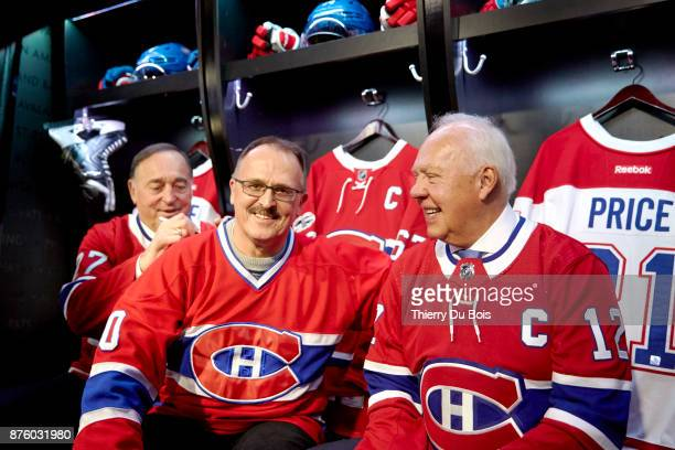 Frank Mahovlich signs a jersey and Yvan Cournoyer poses with a fan during the NHL Centennial 100 Celebration on November 18 2017 at the Bell Centre...