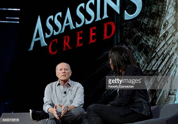 Frank Marshall producer of the film 'Assassins Creed' talks with actress and host Aisha Tyler during an Ubisoft news conference before the start of...