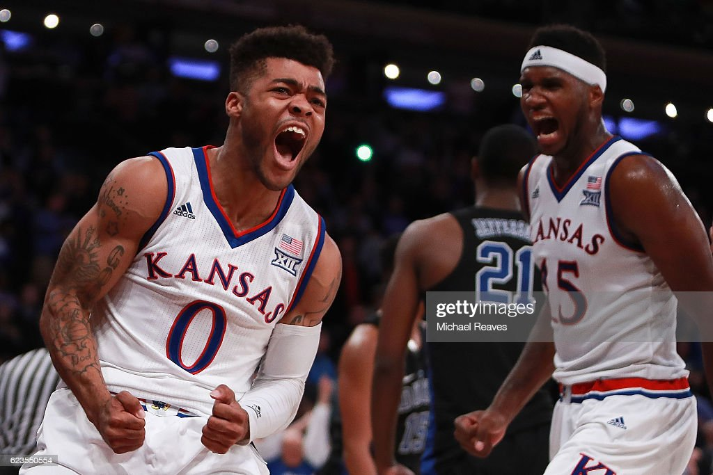 Frank Mason III #0 and Carlton Bragg Jr. #15 of the Kansas Jayhawks react after a foul against the Duke Blue Devils in the second half during the State Farm Champions Classic at Madison Square Garden on November 15, 2016 in New York City.
