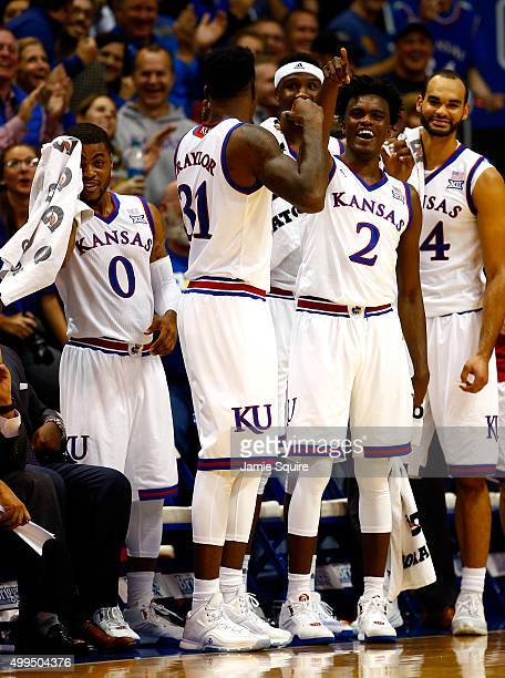 Frank Mason III Jamari Traylor Carlton Bragg Jr #15 Lagerald Vick and Perry Ellis of the Kansas Jayhawks react from the bench after a dunk by Cheick...