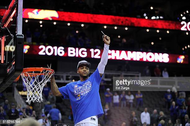 Frank Mason III of the Kansas Jayhawks celebrates after cutting down part the net after Kansas won the Big 12 Basketball Tournament against the West...