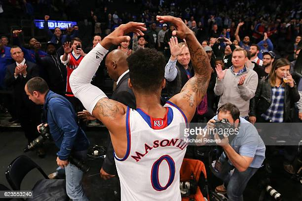 Frank Mason III of the Kansas Jayhawks celebrates after hitting a gamewinning shot with 18 seconds remaining against the Duke Blue Devils in the...