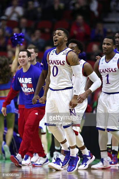 Frank Mason III of the Kansas Jayhawks celebrates with teammates in the second half against the Austin Peay Governors during the first round of the...