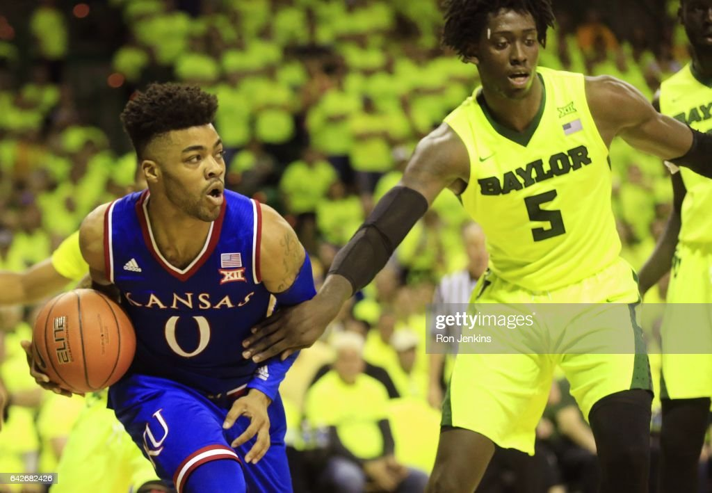 Frank Mason III #0 of the Kansas Jayhawks drives inside as Johnathan Motley #5 of the Baylor Bears defends in the second half at the Ferrell Center on February 18, 2017 in Waco, Texas. Kansas won 67-65.