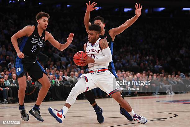 Frank Mason III of the Kansas Jayhawks drives to the basket against Chase Jeter of the Duke Blue Devils in the second half during the State Farm...