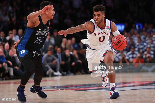 Frank Mason III of the Kansas Jayhawks drives to the basket against Frank Jackson of the Duke Blue Devils in the second half during the State Farm...