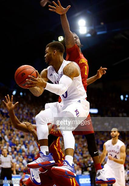 Frank Mason III of the Kansas Jayhawks drives to the basket as Jameel McKay of the Iowa State Cyclones defends during the game at Allen Fieldhouse on...