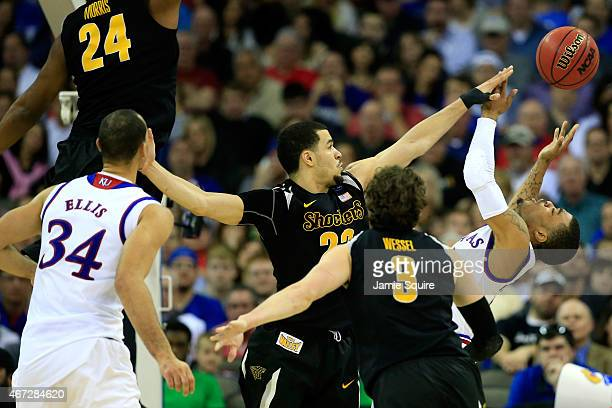 Frank Mason III of the Kansas Jayhawks has a shot blocked by Fred VanVleet of the Wichita State Shockers in the second half during the third round of...