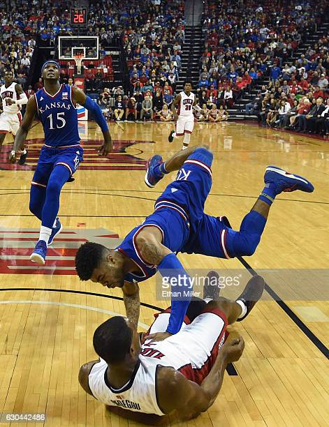 Frank Mason III of the Kansas Jayhawks is called for an offensive foul as he drives into Uche Ofoegbu of the UNLV Rebels during their game at the...