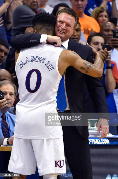 Frank Mason III of the Kansas Jayhawks is hugged by head coach Bill Self as he leaves a game against the Oklahoma Sooners in the second half at Allen...