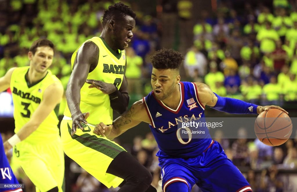 Frank Mason III #0 of the Kansas Jayhawks looks inside as Jo Lual-Acuil Jr. #0 of the Baylor Bears defends in the second half at the Ferrell Center on February 18, 2017 in Waco, Texas. Kansas won 67-65.