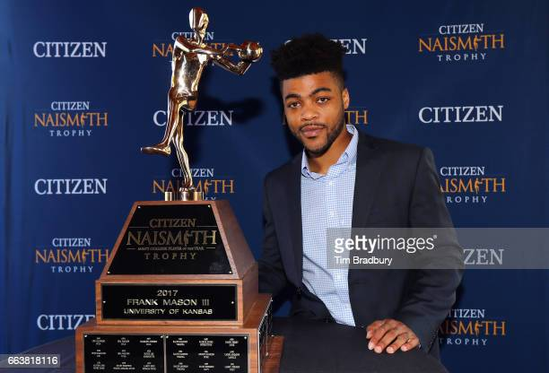 Frank Mason III of the Kansas Jayhawks poses with the 2017 Naismith Player of the Year Award during the 2017 Naismith Awards Brunch at the Grayhawk...