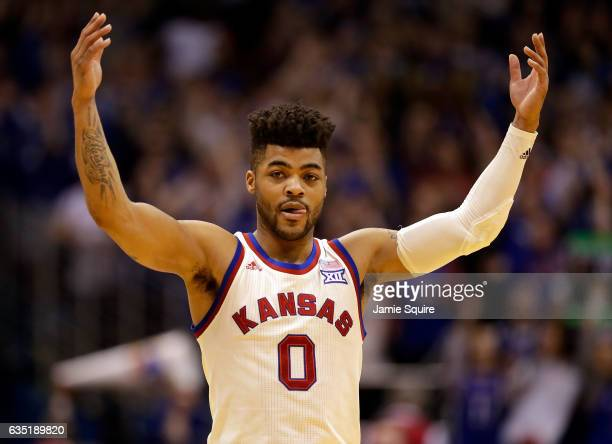 Frank Mason III of the Kansas Jayhawks pumps up the crowd during the game against the West Virginia Mountaineers at Allen Fieldhouse on February 13...