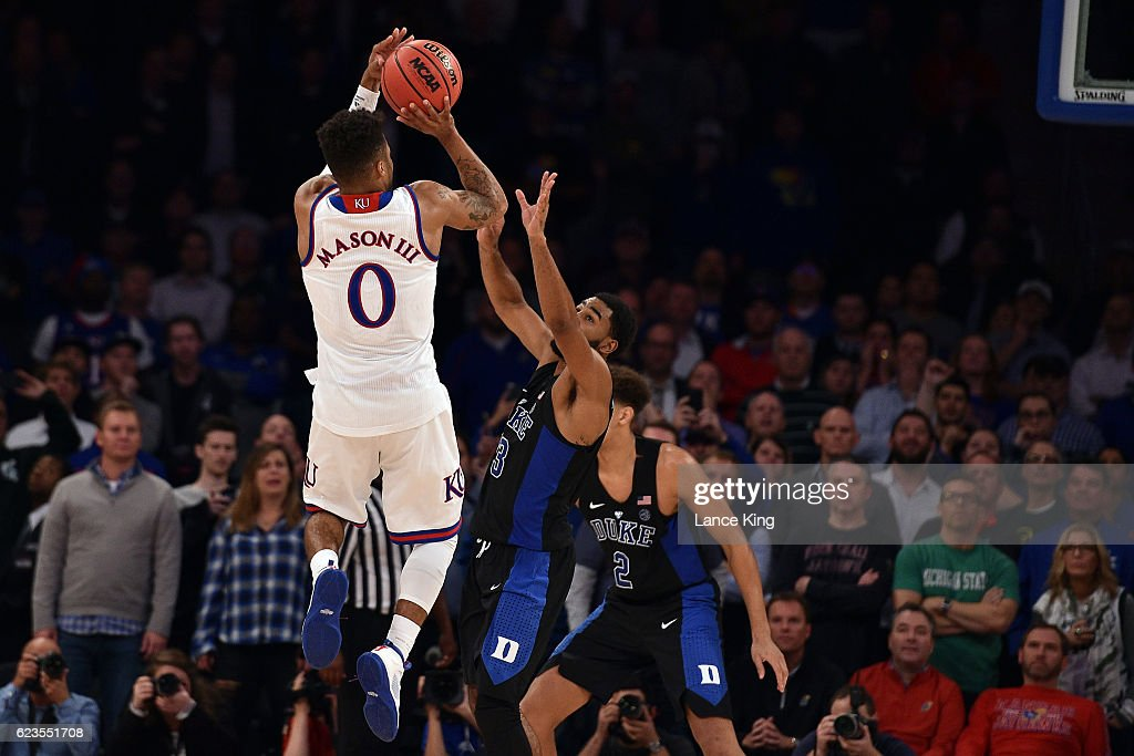 Frank Mason III #0 of the Kansas Jayhawks puts up the game-winning shot against Matt Jones #13 of the Duke Blue Devils with three seconds remaining in the game during the State Farm Champions Classic at Madison Square Garden on November 15, 2016 in New York City. Kansas won 77-75.