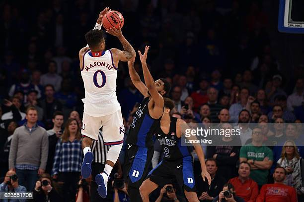 Frank Mason III of the Kansas Jayhawks puts up the gamewinning shot against Matt Jones of the Duke Blue Devils with three seconds remaining in the...