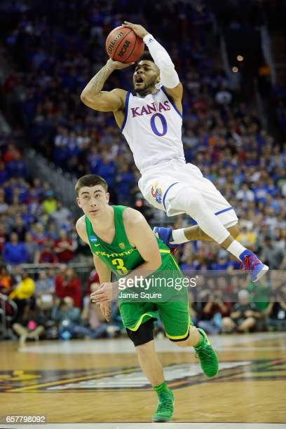 Frank Mason III of the Kansas Jayhawks shoots the ball against Payton Pritchard of the Oregon Ducks in the first half during the 2017 NCAA Men's...