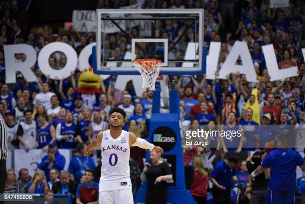 Frank Mason III of the Kansas Jayhawks stretch prior to a game against the Oklahoma Sooners at Allen Fieldhouse on February 27 2017 in Lawrence Kansas