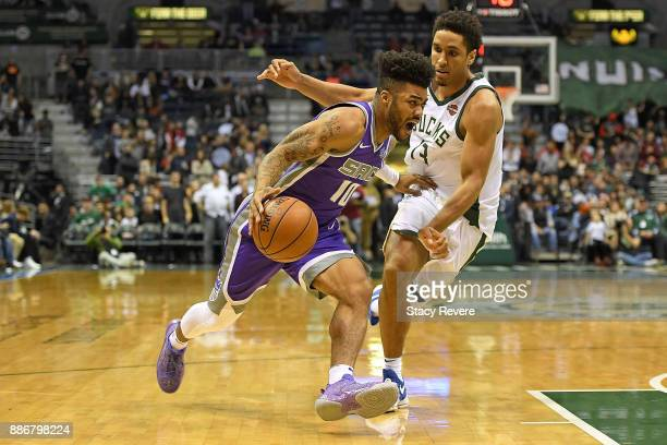 Frank Mason III of the Sacramento Kings drives to the basket against Malcolm Brogdon of the Milwaukee Bucks during a game at the Bradley Center on...