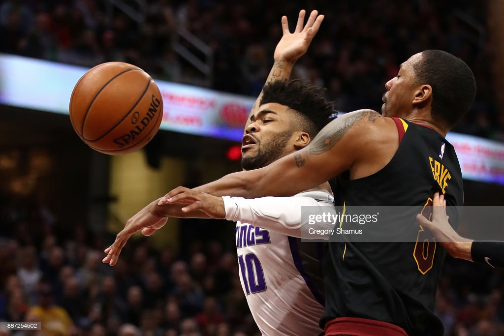 Frank Mason III #10 of the Sacramento Kings drives to the basket but is fouled by Channing Frye #8 of the Cleveland Cavaliers during the first half at Quicken Loans Arena on December 6, 2017 in Cleveland, Ohio.