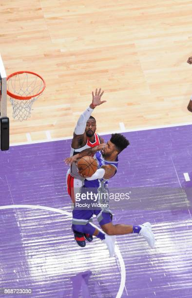 Frank Mason III of the Sacramento Kings goes up for the shot against John Wall of the Washington Wizards on October 29 2017 at Golden 1 Center in...