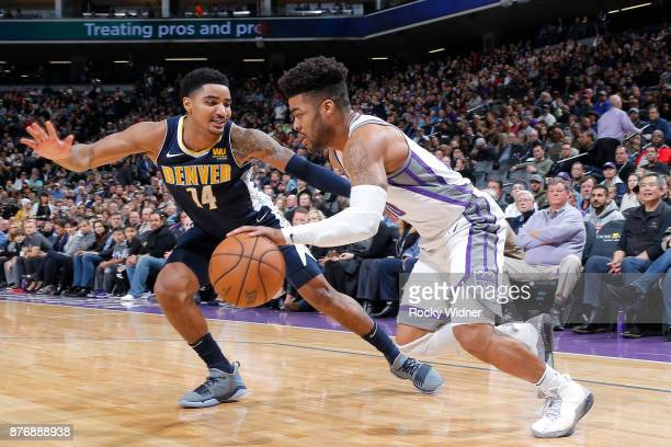 Frank Mason III of the Sacramento Kings handles the ball against Gary Harris of the Denver Nuggets on November 20 2017 at Golden 1 Center in...
