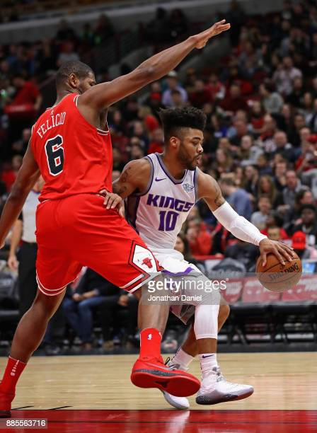 Frank Mason III of the Sacramento Kings moves against Cristiano Felicio of the Chicago Bulls at the United Center on December 1 2017 in Chicago...