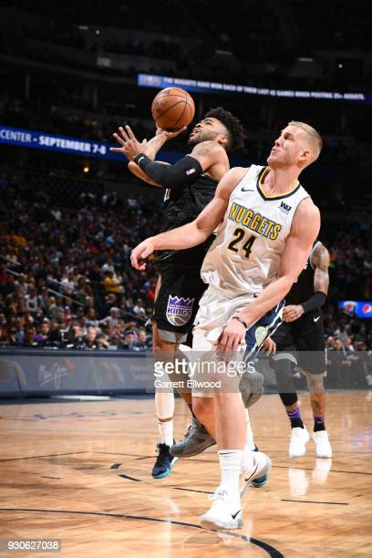 Frank Mason III of the Sacramento Kings passes the ball against Mason Plumlee of the Denver Nuggets on March 11 2018 at the Pepsi Center in Denver...