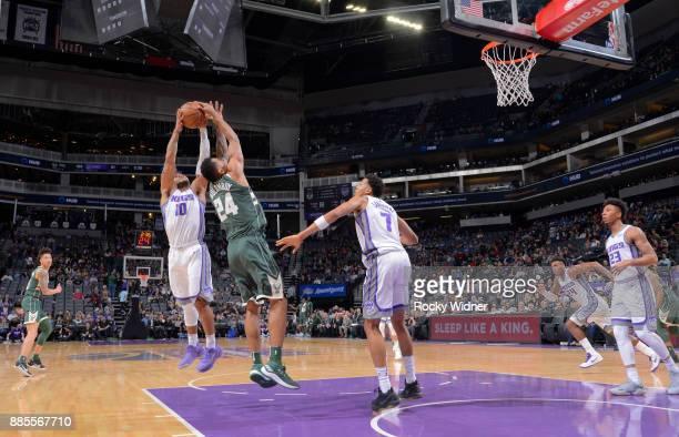 Frank Mason III of the Sacramento Kings rebounds against Joel Bolomboy of the Milwaukee Bucks on November 28 2017 at Golden 1 Center in Sacramento...