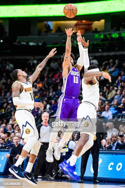 Frank Mason III of the Sacramento Kings shoots a halftime buzzerbeater three point basket over Torrey Craig of the Denver Nuggets at Pepsi Center on...