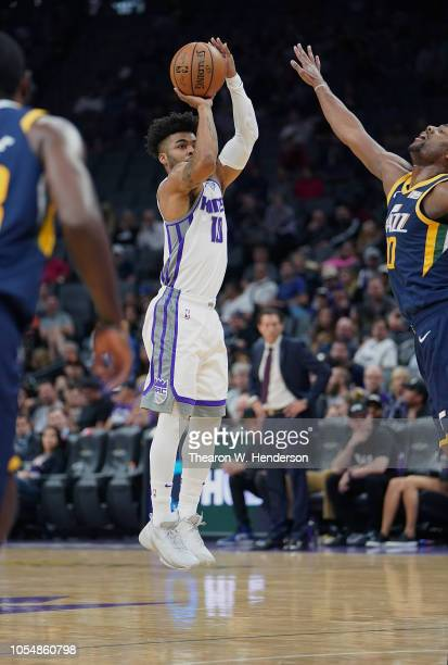 Frank Mason III of the Sacramento Kings shoots over Alec Burks of the Utah Jazz during the second half of their NBA basketball game at Golden 1...