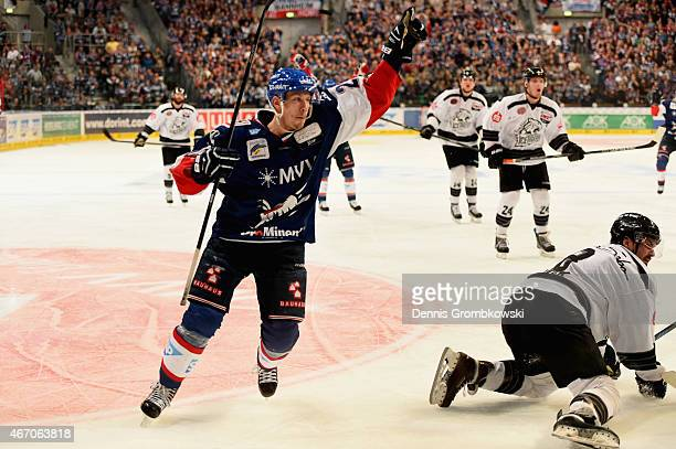Frank Mauer of Adler Mannheim celebrates as he scores the winning goal in overtime during the DEL Ice Hockey Playoffs Quarter Final Game 5 between...