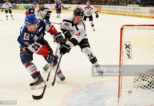 Frank Mauer of Adler Mannheim scores their second goal during the DEL Ice Hockey Playoffs Quarter Final Game 5 between Alder Mannheim and Thomas Sabo...