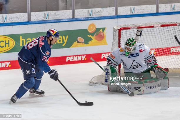 Frank Mauer of EHC Red Bull Muenchen and goalkeeper Markus Keller of Augsburger Panther battle for the puck during the DEL match between EHC Red Bull...