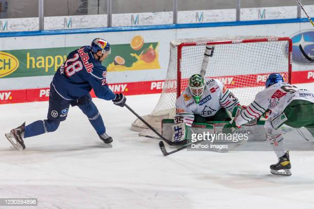 Frank Mauer of EHC Red Bull Muenchen, goalkeeper Markus Keller of Augsburger Panther and Alex Lambacher of Augsburger Panther battle for the puck...