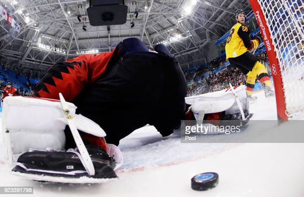 Frank Mauer of Germany celebrates a second period goal against Kevin Poulin of Canada during the Men's Playoffs Semifinals on day fourteen of the...