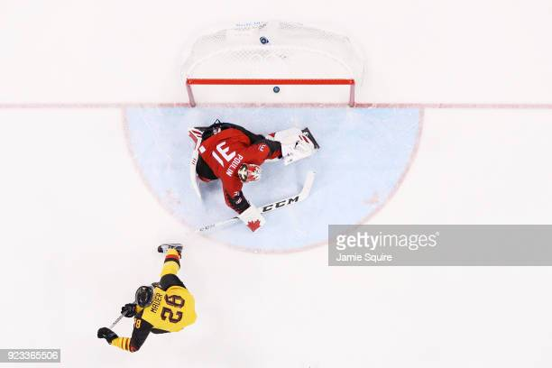 Frank Mauer of Germany scores a goal in the second perios against Kevin Poulin of Canada during the Men's Playoffs Semifinals on day fourteen of the...