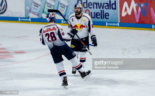 Frank Mauer of Muenchen celebrates the second goal for his team with Daryl Boyle of Muenchen during the first game of the DEL PlayOffs Final between...