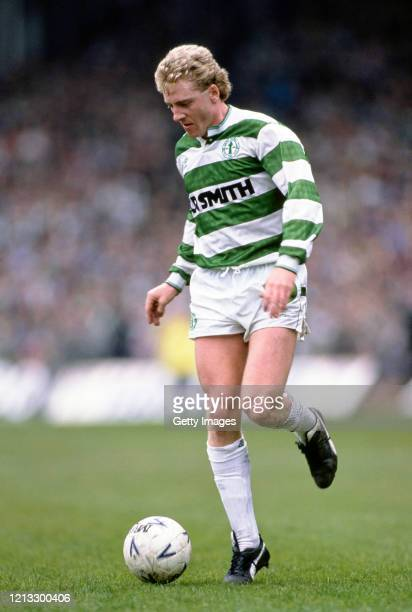 Frank McAvennie of Celtic in action wearing Puma boots controlling a Mitre ball during a Scottish Premier match against Dundee at Park Head on April...