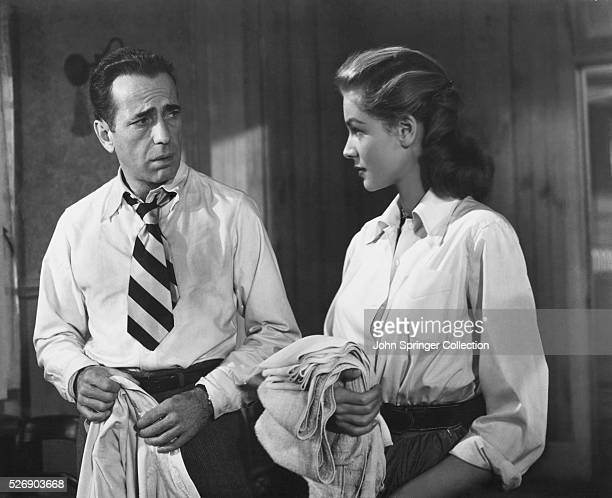 Frank McCloud and Nora Temple stare at one another in a scene from the 1948 film Key Largo