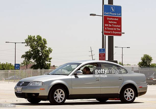 Frank McNichols sits in his car reading as waits to pick up an arriving airport traveler while parked in the new Cell Phone Lot June 5 2006 at O'Hare...