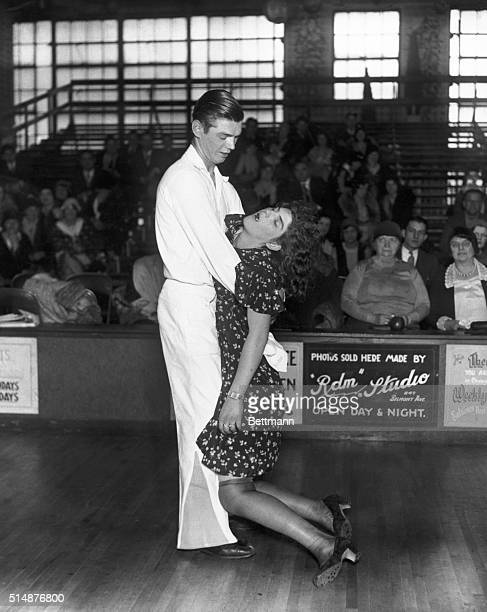 Frank Micholowsky holds his exhausted sister and dance partner Marie Micholowsky after a marathon dance competition