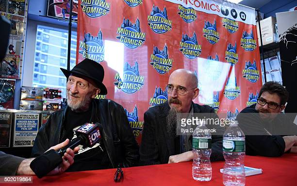 Frank Miller Brian Azzerello and Andy Kubert attend Dark Knight III The Master Race signing at Midtown Comics on December 19 2015 in New York City