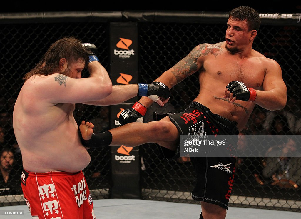 Frank Mir kicks Roy Nelson during their heavyweight fight at UFC 130 at the MGM Grand Garden Arena on May 28, 2011 in Las Vegas, Nevada.